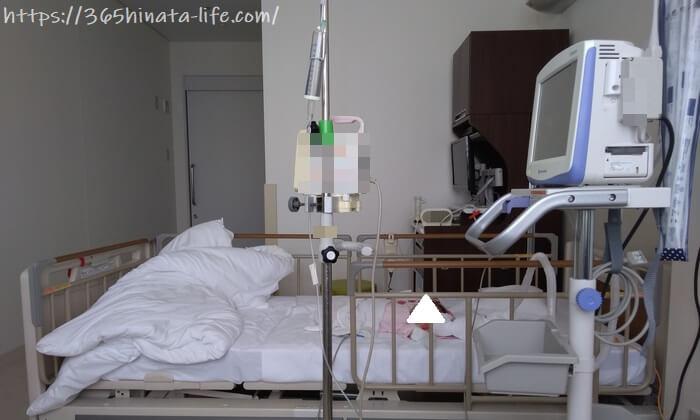 呼吸管理を受ける新生児の娘